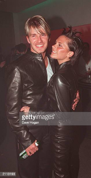 English soccer sensation David Beckham and singer Victoria 'Posh Spice' Adams embrace at the Versace store party on June 11 in New Bond Street London...