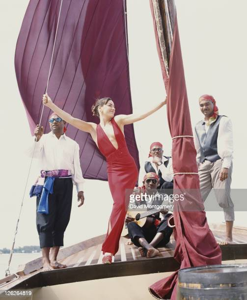 English socialite and columnist Tara PalmerTomkinson on the deck of a yacht with a group of men in pirate costume 1998