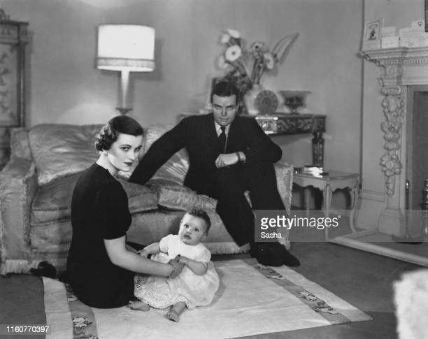 English socialite Margaret Sweeny , at home with her husband, Charles Sweeny , and their daughter, Frances, 28th January 1938. Margaret Sweeny later...