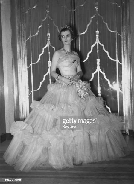 English socialite Margaret Sweeny wearing a pink ballgown, 2nd December 1938.