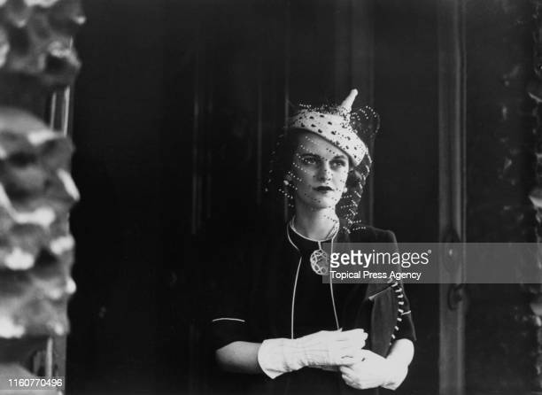 English socialite Margaret Sweeny wearing a veiled hat and matching gloves, London, 5th May 1938. She is leaving Derby House on Stratford Place after...