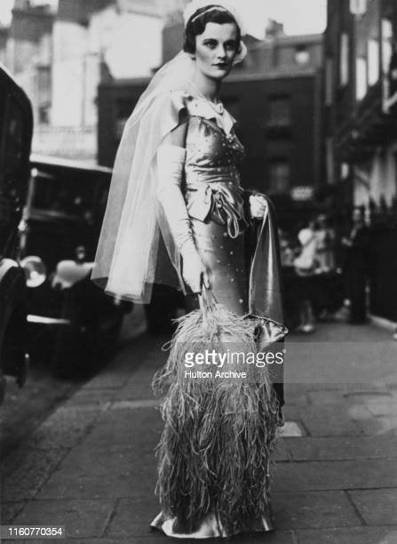 English socialite Margaret Whigham on her way to be presented at Court at Buckingham Palace, London, 1930. She was subsequently named 'Debutante of...