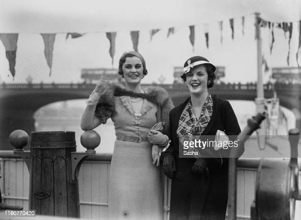 English socialite Margaret Whigham with a friend on board a boat travelling down the river Thames, London, June 1930.