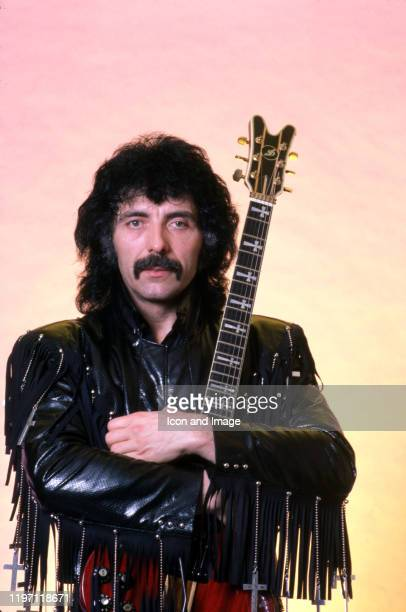 English songwriter producer lead guitarist and founding member of the heavy metal band Black Sabbath Tony Iommi poses for a portrait backstage at...
