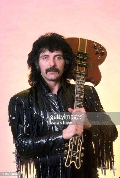 English songwriter, producer, lead guitarist and founding member of the heavy metal band Black Sabbath, Tony Iommi, poses for a portrait backstage at...