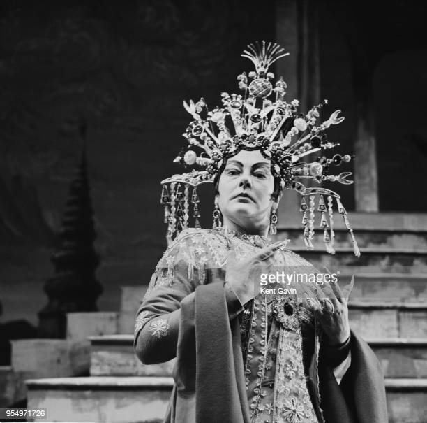English soprano Amy Shuard wearing a costume designed by Cecil Beaton during rehearsals for the Puccini opera 'Turandot' at the Royal Opera House in...
