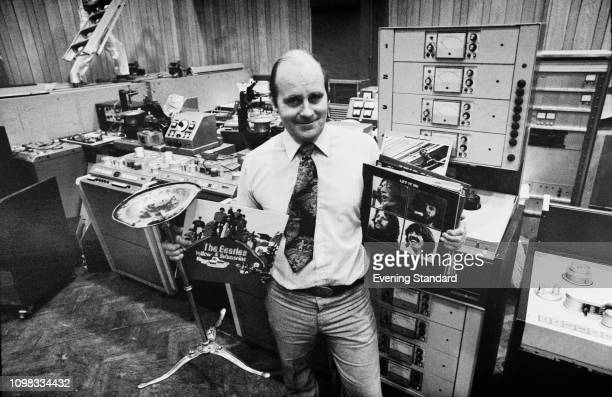 English sound engineer Ken Townsend in the control room of Studio 2 at Abbey Road recording studios with Beatles albums UK 14th October 1980