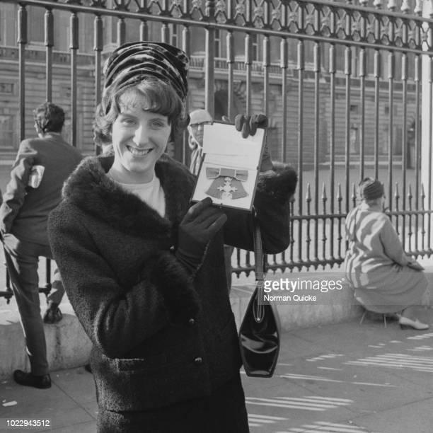 English sprinter Dorothy Hyman with her MBE outside Buckingham Palace London UK 6th November 1965