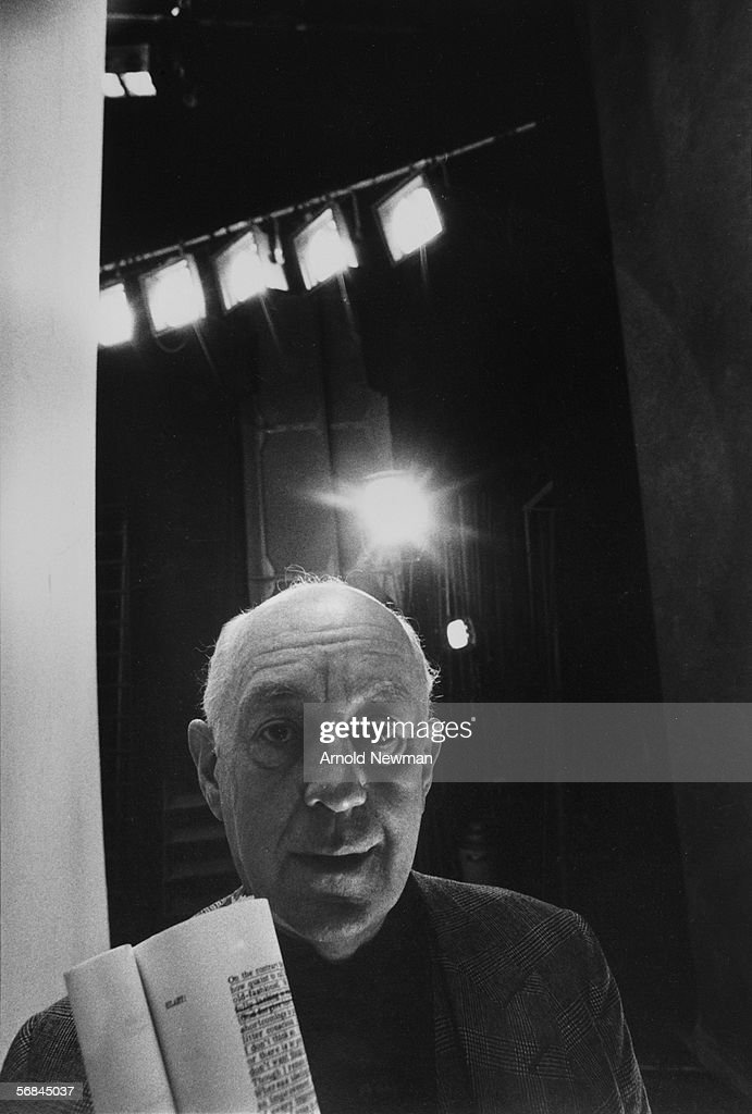English stage and screen actor Alec Guinness (1914 - 2000) holds a script for Alan Bennett's play 'The Old Country,' backstage at the Queen's Theatre, Shaftesbury Avenue, London, 1977. In the play Guinness takes the role of Hilary, an aging spy, which was specifically written for him by Bennett.