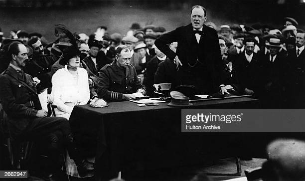 English statesman Sir Winston Churchill First Lord of the Admiralty speaking at Enfield His wife Baroness SpencerChurchill is seated on the left