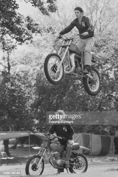 English stunt performer Eddie Kidd performing a motorcycle stunt with his wife Sarah on a motocross, UK, 21st May 1979.