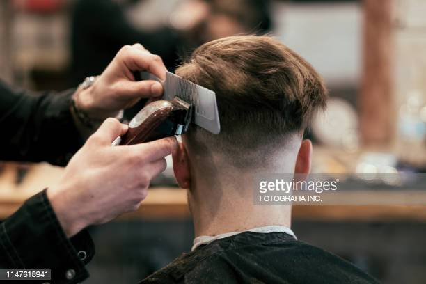english style barber shop action - barber stock pictures, royalty-free photos & images