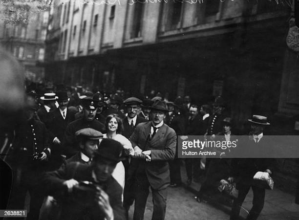 English suffragette Annie Kenney is arrested during a demonstration