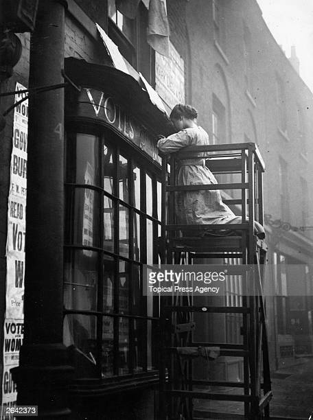 English suffragette Estelle Sylvia Pankhurst daughter of Emmeline Pankhurst and sister of Christabel at work on the facia of the Women's Social...