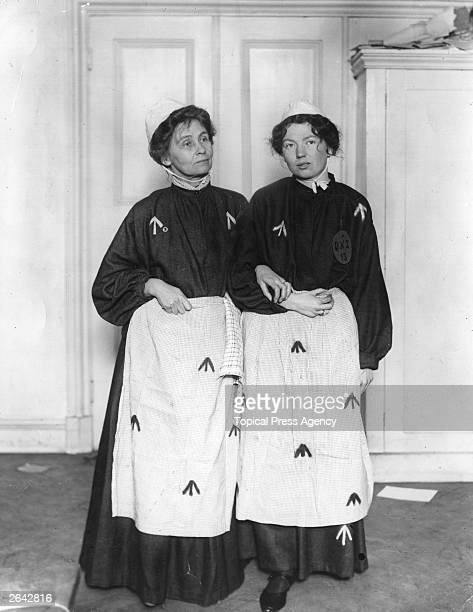 English suffragette leader Emmeline Pankhurst and her daughter Christabel founders of the Women's Social and Political Union wearing prison uniforms...