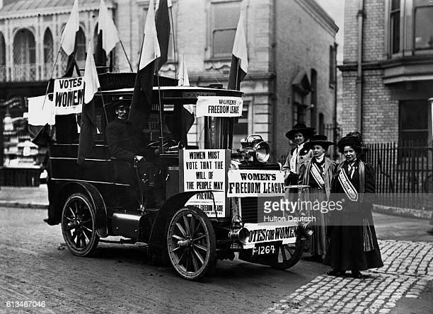 English suffragettes drive through Chelmsford during an election campaign