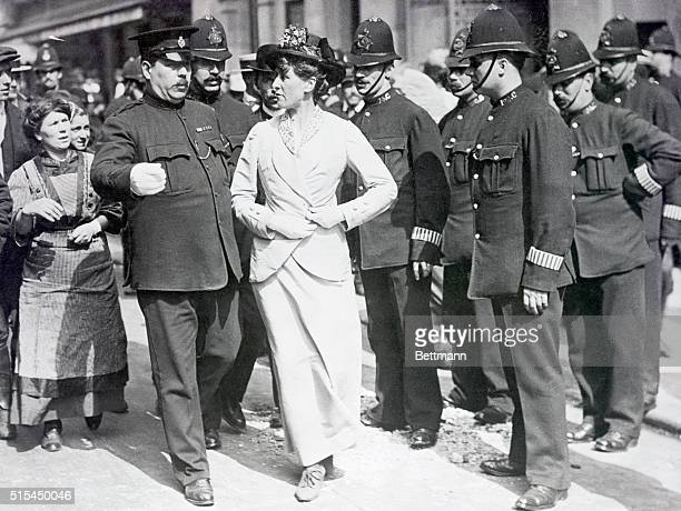 English suffragist about to be arrested by stern but polite English policemen Photograph ca 1912