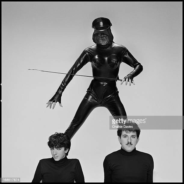 English synthpop duo Marc Almond and David Ball of Soft Cell, photographed with Miss Bond the Governess in London, 1981.