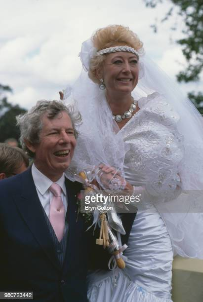 English tabloid journalist and broadcaster Derek Jameson with his bride Ellen Petrie on their wedding day Essex UK 9th March 1988