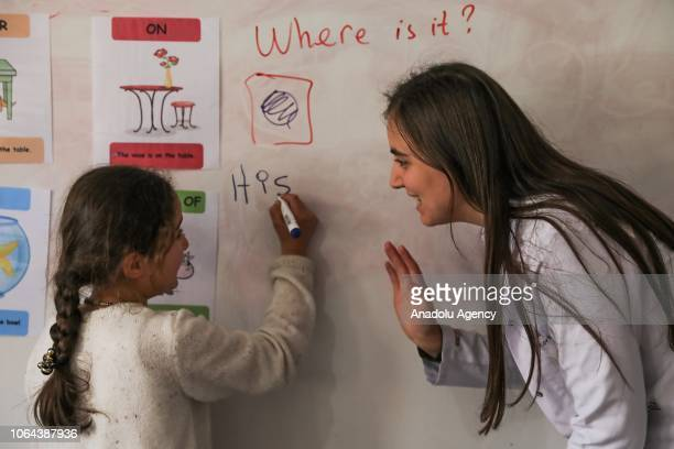 English teacher Aynur Korkmaz is seen with her student during their lesson at the Alacayar Secondary School in Catak district of Van Turkey on...