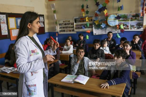 English teacher Aynur Korkmaz is seen with her students during their lesson at the Alacayar Secondary School in Catak district of Van Turkey on...