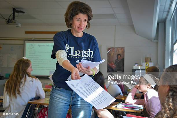 English teacher Kathy Hansen casually dressed in jeans and a tshirt hands out papers during class at WT Woodson High School on Thursday February 6 in...