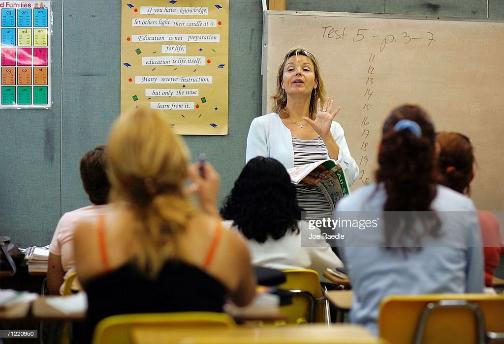 English teacher Radka Tomasek speaks to the class at the English Center June 16, 2006 in Miami, Florida. The school holds adult education classes that include English language classes for people who have immigrated to the United States. U.S. President George W. Bush recently said, ?Part of the greatness of America is that we've been able to help assimilate people into our society... And part of that assimilation process is English. I believe this: If you learn English, and you're a hard worker, and you have a dream, you have the capacity from going from picking crops to owning the store, or from sweeping office floors to being an office manager.?
