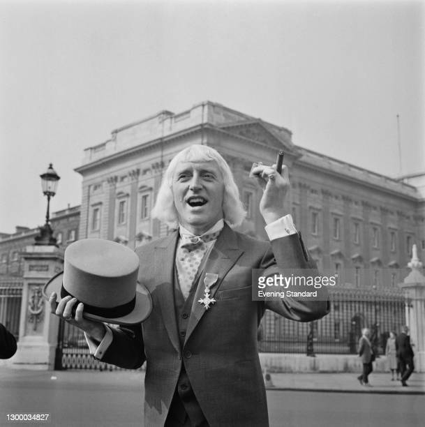 English television and radio personality Jimmy Savile outside Buckingham Palace in London after receiving his OBE, UK, 21st March 1972.