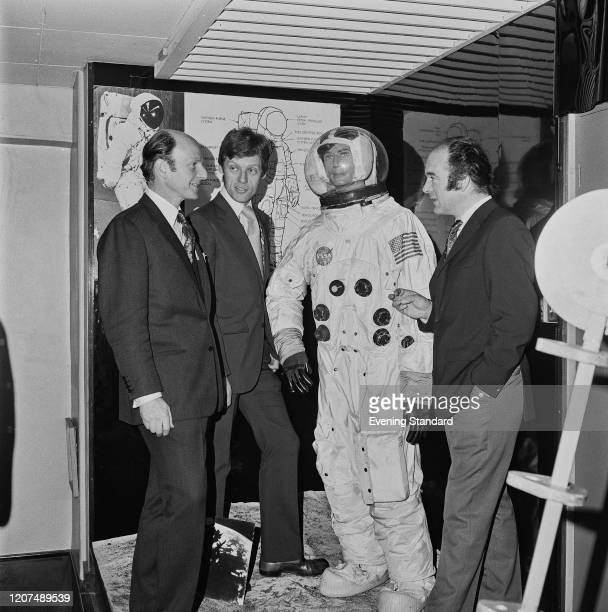 English television director and producer Barry Letts stands on right with actor Richard Franklin and Monty Moor at a space exhibition on 21st June...