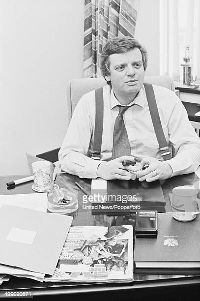English television executive and controller of Popperfoto via Getty Images One Michael Grade posed in his London office on 28th February 1986