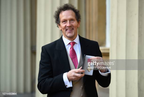 English television presenter and horticulturalist Monty Don poses with his medal after being appointed an Officer of the Order of the British Empire...