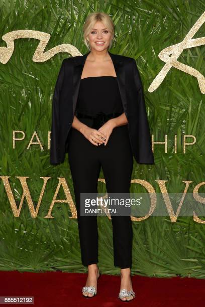 English television presenter and model Holly Marie Willoughby poses on the red carpet upon arrival to attend the British Fashion Awards 2017 in...