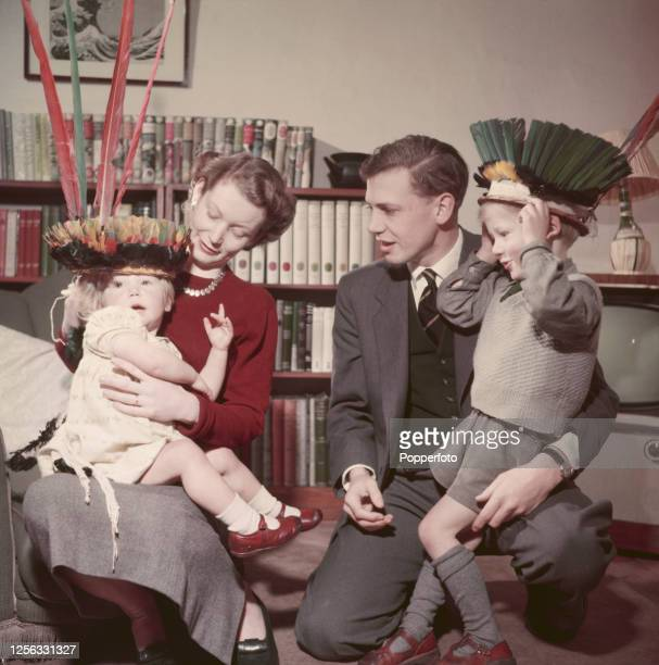 English television presenter and producer David Attenborough at home with his wife Jane and children Robert and Susan in March 1956. David...