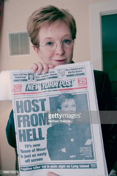 English television presenter Anne Robinson with a copy of the New York Post with the headline 'Host from Hell' referring to her 'Queen of Mean'...