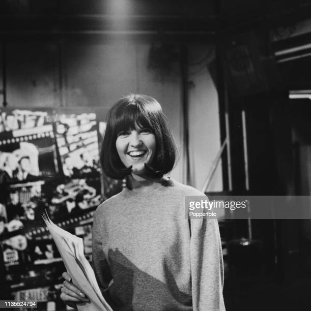 English television presenter Cathy McGowan pictured on the set of the music television show Ready Steady Go soon after joining the programme as host...