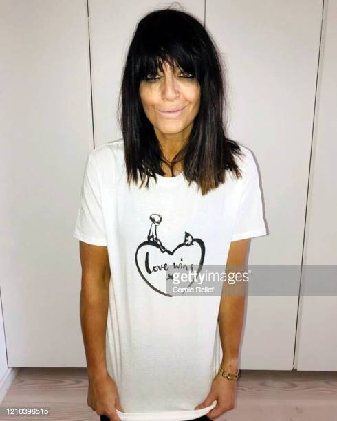 English television presenter Claudia Winkleman, wearing a limited-edition t-shirt created in collaboration with Charlie Mackesy featuring his beloved...