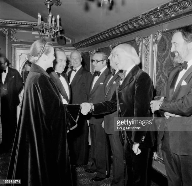 English television presenter Jimmy Savile meets Prince Rainier III and Princess Grace of Monaco circa 1980