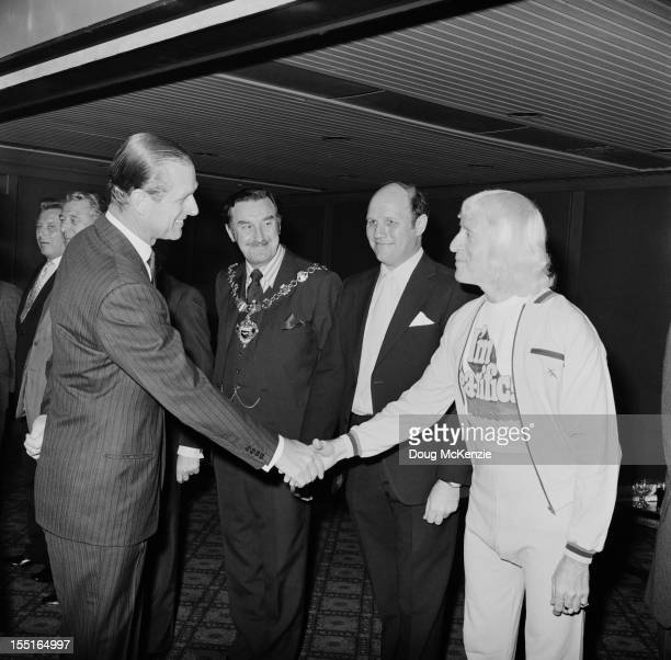 English television presenter Jimmy Savile meets the Duke of Edinburgh during a Variety Club of Great Britain charity walk luncheon 19th April 1973