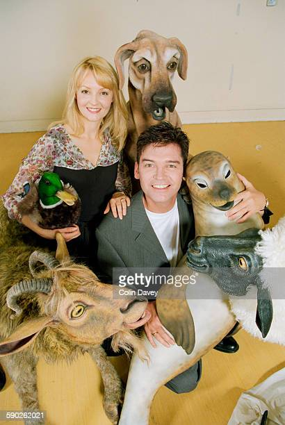 English television presenter Phillip Schofield with costar Sarah Jane Hassell and various model animals during a photocall for the stage musical 'Dr...