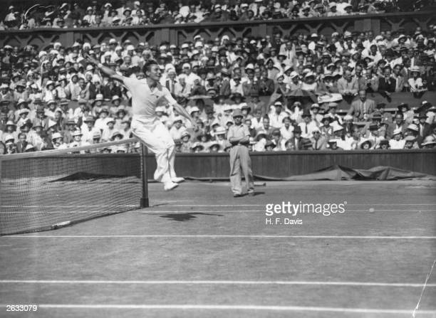 English tennis champion Fred Perry leaps over the net after defeating Australia's Jack Crawford in the men's singles final at Wimbledon Original...