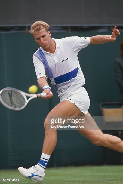 English tennis player Andrew Castle pictured in action competing to progress to the second round of the Men's Singles tournament at the Wimbledon...