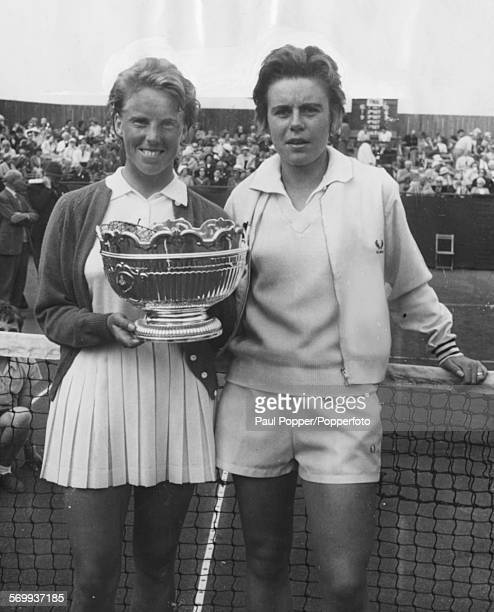 English tennis player Ann HaydonJones with runnerup Norma Baylon holds a trophy after winning the British Hard Court Championships in Bournemouth...