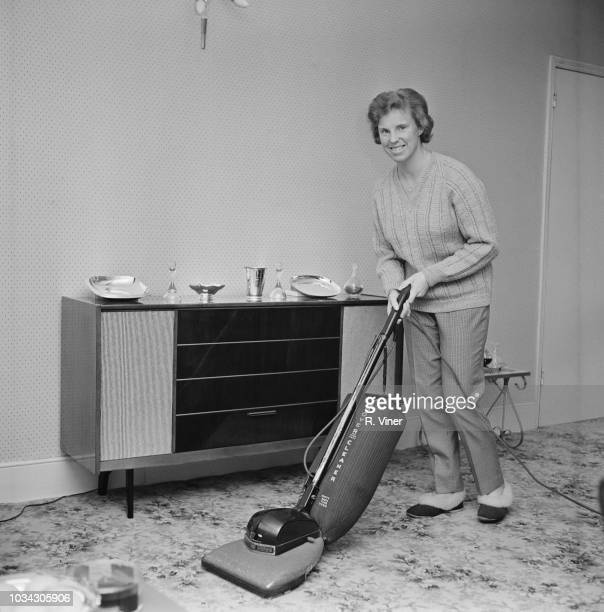 English tennis player Ann Jones doing housework and vacuuming at her house UK 21st February 1963