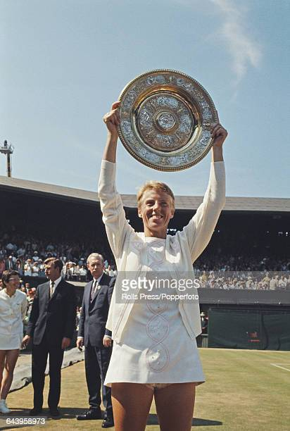 English tennis player Ann Jones holds up the Venus Rosewater Dish trophy after beating Billie Jean King of the United States 36 63 62 in the final of...