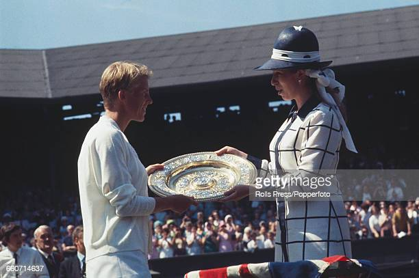 English tennis player Ann Jones is presented with the Venus Rosewater Dish trophy by Princess Anne after winning the final of the Ladies' Singles...