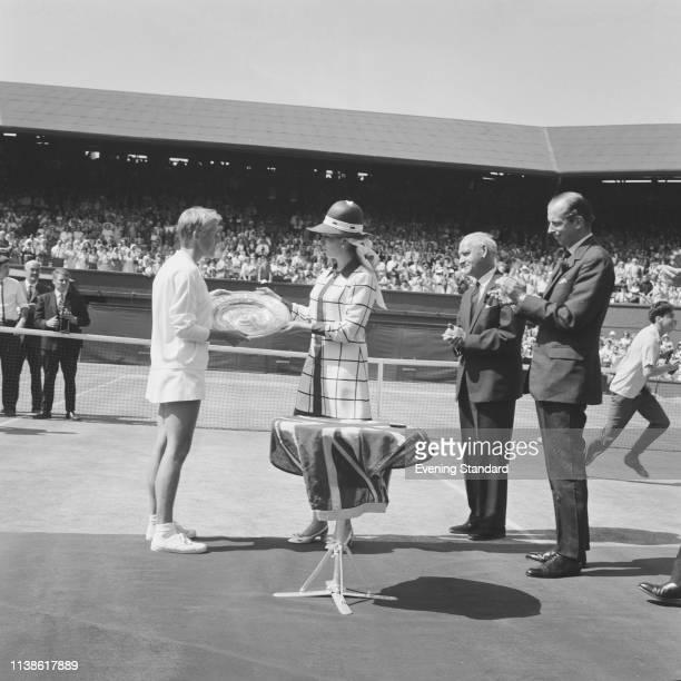 English tennis player Ann Jones receiving her trophy from Princess Anne after winning the Women's Singles Final at Wimbledon Championships All...