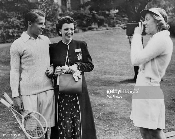 English tennis player Bunny Austin holding his three segment Hazells Streamline White Star tennis racquet poses with his wife Phyllis Konstam as they...
