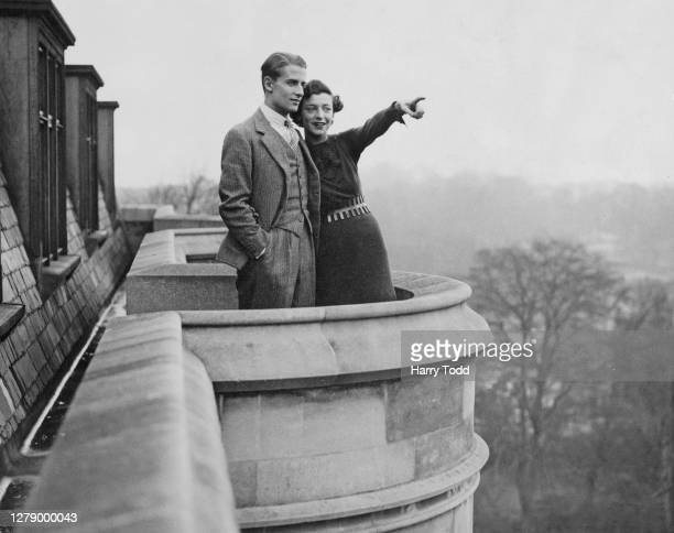 English tennis player Bunny Austin with his wife, the actress and tennis player, Phyllis Konstam look out from their apartment balcony overlooking...