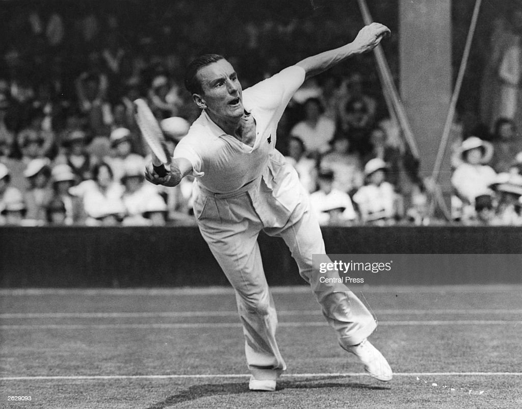 English tennis player Fred Perry in action against Roderick Menzel of Czechoslovakia during the championship at Wimbledon. He was three times Wimbledon champion.
