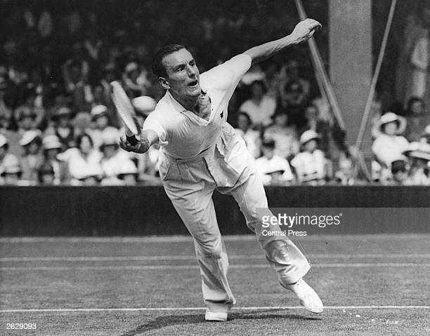 English tennis player Fred Perry in action against Roderick Menzel of Czechoslovakia during the championship at Wimbledon. He was three times...